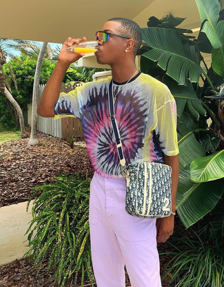 How to wear: multi colored tie-dye crew-neck t-shirt, light violet chinos, yellow print canvas messenger bag, orange sunglasses