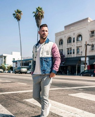 How to wear: multi colored denim jacket, white crew-neck t-shirt, grey jeans, white canvas low top sneakers