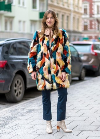 How to Wear Navy Flare Jeans: As you can see here, looking classy doesn't take that much effort. Try teaming a multi colored fur coat with navy flare jeans and you'll look amazing. If you're not sure how to finish, a pair of beige leather ankle boots is a tested option.