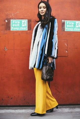 Go for a sophisticated look in a multi colored vertical striped fur coat and 3.1 Phillip Lim women's Wool Drawstring Waist Wide Leg Pants. Round off this look with black leather ankle boots. Needless to say, this outfit is the answer to all of your wintry wear woes.