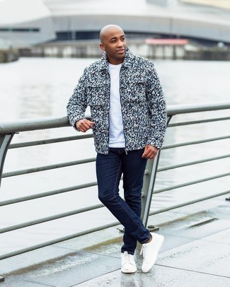 Men's Outfits 2020: You'll be surprised at how very easy it is for any man to get dressed like this. Just a multi colored wool harrington jacket worn with navy jeans. If not sure as to what to wear in the footwear department, complement this look with white leather low top sneakers.