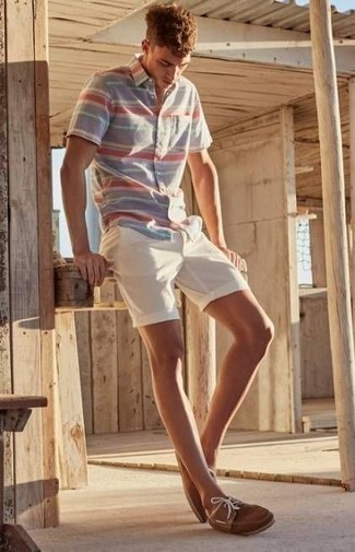 Men's Looks & Outfits: What To Wear In 2020: This casual and cool ensemble is so simple: a multi colored horizontal striped short sleeve shirt and white shorts. The whole ensemble comes together when you complement this look with a pair of brown suede boat shoes.