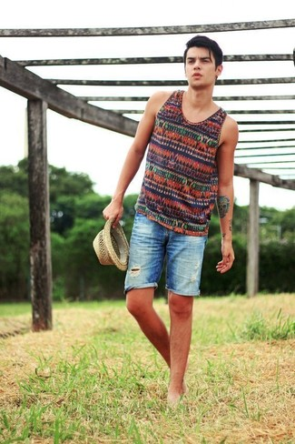 How to wear: multi colored horizontal striped tank, blue ripped denim shorts, beige straw hat