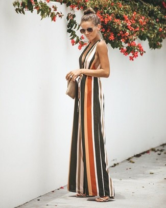 How to Wear a Beige Leather Clutch: Why not wear a multi colored vertical striped jumpsuit with a beige leather clutch? Both pieces are very comfortable and look fabulous married together. Turn up the formality of this ensemble a bit by sporting grey leather heeled sandals.