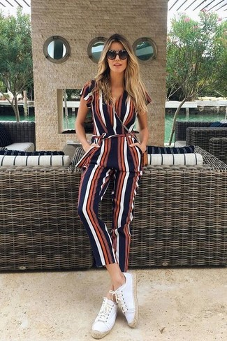 How to wear: multi colored vertical striped jumpsuit, white canvas espadrilles, tobacco leather crossbody bag, black sunglasses