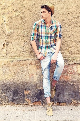 A multi colored plaid long sleeve shirt and light blue ripped skinny jeans will convey a carefree easy vibe. Tan suede desert boots will instantly dress up even the laziest of looks. As you know, the key to getting through the hottest time of year is sporting cool outfits like this one.