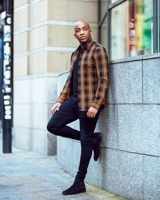 Men's Outfits 2020: Extremely stylish and comfortable, this combo of a multi colored plaid long sleeve shirt and navy skinny jeans provides countless styling opportunities. Complement this outfit with black suede chelsea boots to jazz things up.