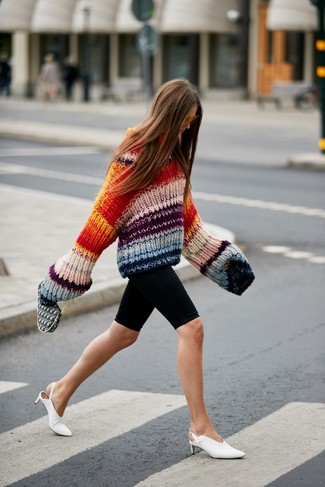 How to wear: multi colored knit oversized sweater, black bike shorts, white leather mules, orange sunglasses