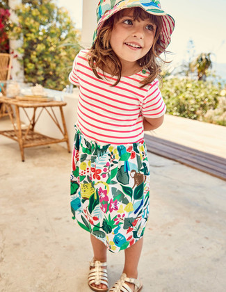 Let your little one perfect the smart casual look in multi colored print dress. Finish off this getup with gold sandals.