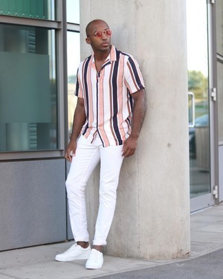 White Jeans Outfits For Men: Wear a multi colored vertical striped short sleeve shirt and white jeans for relaxed dressing with a contemporary spin. White canvas low top sneakers are a welcome companion to this outfit.