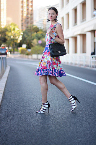 Nail glam in a multi colored floral skater dress. Lift up your look with white and black leather heeled sandals. We're loving that this combination is ideal when hot weather hits.