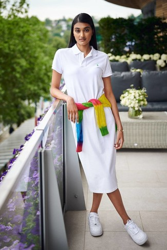 How to wear: multi colored tie-dye cable sweater, white shirtdress, white leather low top sneakers