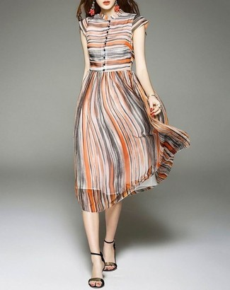 How to wear: multi colored vertical striped midi dress, black and gold leather heeled sandals, orange earrings
