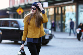 Pair a mustard biker jacket with black slim jeans to create a chic, glamorous look. Loving how this ensemble gets you excited for chillier weather in seconds time.