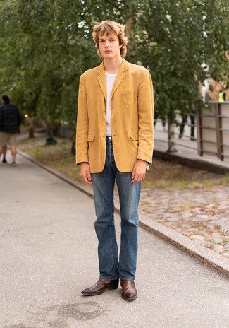 White Crew-neck T-shirt Outfits For Men: Consider teaming a white crew-neck t-shirt with blue jeans for an everyday look that's full of charm and character. Our favorite of an endless number of ways to round off this look is brown leather chelsea boots.