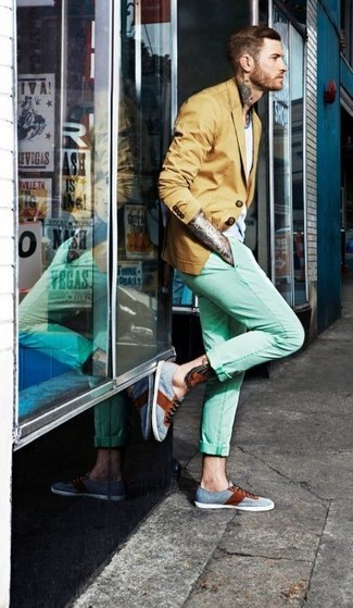 A mustard jacket and mint chinos are a great outfit formula to have in your arsenal. Dress down this getup with grey plimsolls.