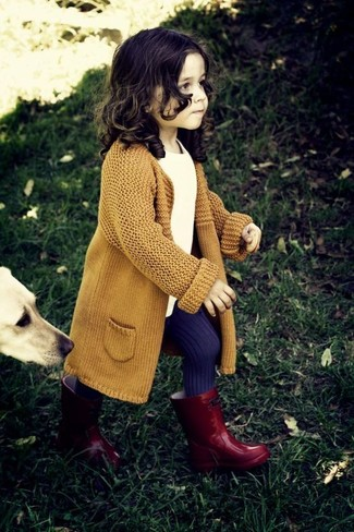 How to wear: mustard cardigan, white t-shirt, red rain boots, violet tights