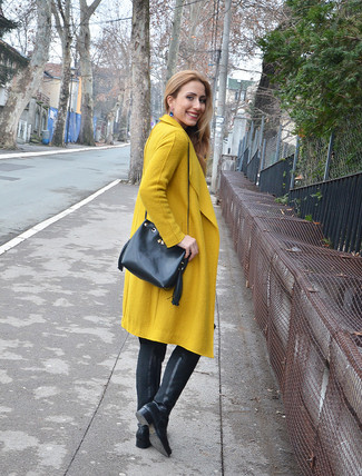 Opt for a mustard coat if you're going for a neat, stylish look. This outfit is complemented perfectly with black leather over the knee boots.