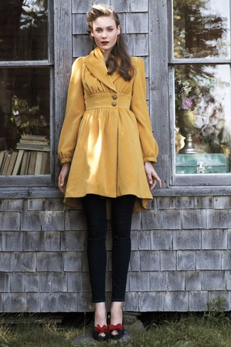 Wear a mustard coat with black skinny pants for a seriously stylish look. This outfit is complemented perfectly with red and black suede pumps. And when you're having one of those dreary fall days, sometimes only a kick-ass outfit like this one can brighten things up.