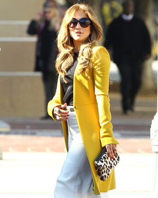 Jennifer Lopez wearing Mustard Coat, Black Sleeveless Top, White Wide Leg Pants, Beige Leopard Suede Clutch