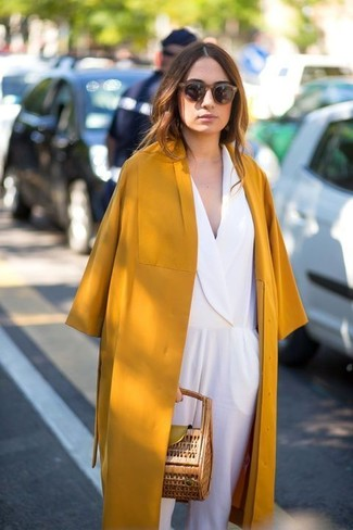 Consider wearing a Boohoo women's Cara Regan Hooded Duster Coat and a white jumpsuit to bring out the stylish in you. We're loving that this combination is ideal when spring comes.