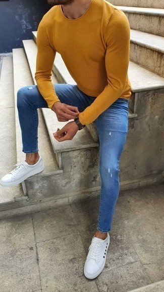 Mustard Crew-neck Sweater Outfits For Men: Demonstrate that nobody does casual quite like you do by opting for a mustard crew-neck sweater and blue ripped skinny jeans. Rev up the dressiness of your outfit a bit by sporting a pair of white canvas low top sneakers.