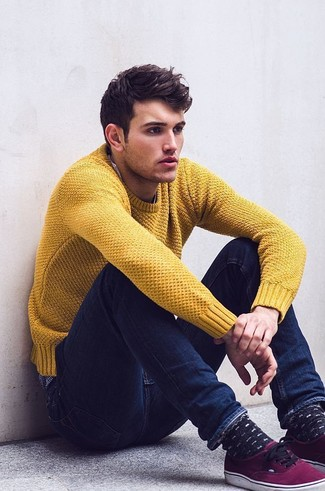How to wear: mustard crew-neck sweater, navy skinny jeans, purple low top sneakers