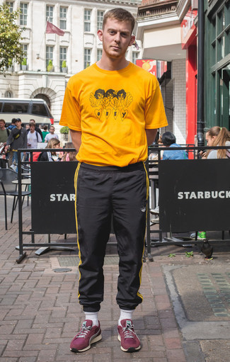 How to Wear Black Sweatpants In Hot Weather In a Relaxed Way For Men: Consider pairing a mustard print crew-neck t-shirt with black sweatpants for a fashionable and laid-back ensemble. Add burgundy athletic shoes to the mix and the whole look will come together.