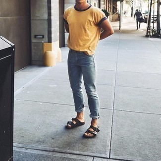 How to Wear a Mustard Crew-neck T-shirt For Men: A mustard crew-neck t-shirt and light blue jeans are essential in any modern gentleman's well-edited casual closet. Inject some much need fun and experimentation into your look via black leather sandals.
