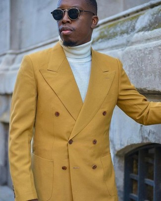 How to wear: mustard double breasted blazer, white turtleneck, black sunglasses