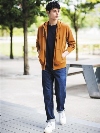If you're hunting for a casual yet seriously stylish look, pair a mustard hoodie with navy jeans. Both items are totally comfortable and will look great paired together. White leather low top sneakers work spectacularly well within this ensemble. So if you're looking for an easy-to-transition look, you found it.