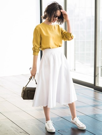 How to wear: mustard long sleeve blouse, white pleated midi skirt, white canvas low top sneakers, olive leather crossbody bag