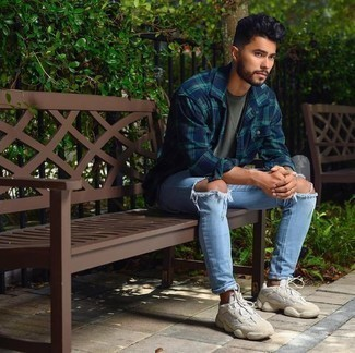 How to Wear Beige Athletic Shoes In a Relaxed Way For Men: A navy and green plaid long sleeve shirt and light blue ripped jeans are a cool outfit formula to have in your off-duty wardrobe. A pair of beige athletic shoes adds edginess to this outfit.