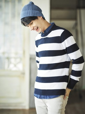 How to wear: navy and white horizontal striped crew-neck sweater, blue chambray long sleeve shirt, white jeans, blue beanie