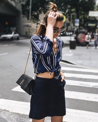 How to wear: navy and white vertical striped silk dress shirt, navy suede mini skirt, black leather crossbody bag, black and gold sunglasses