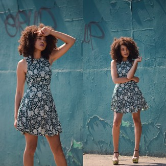Dress in navy and white floral fit and flare dress for a comfy-casual look. Go for a pair of gold leather heeled sandals to va-va-voom your outfit.