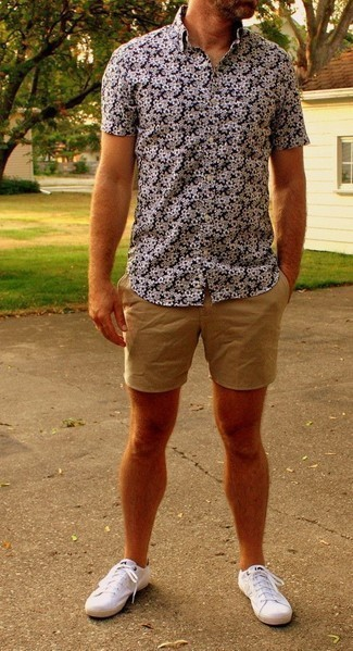 How to Wear a Navy and White Floral Shirt For Men: This casual combo of a navy and white floral shirt and tan shorts is super easy to pull together without a second thought, helping you look stylish and ready for anything without spending too much time digging through your wardrobe. White canvas low top sneakers are an effective way to upgrade this outfit.