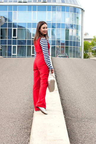 How to wear: navy and white horizontal striped henley shirt, red overalls, white canvas low top sneakers, beige leather handbag