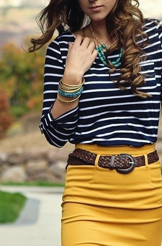 A blue t-shirt and a mustard pencil skirt are both versatile essentials that will give your outfits a subtle modification. Needless to say, an ensemble like this will keep you warm and stylish throughout the season.