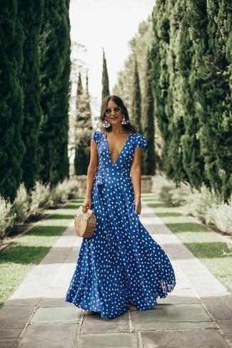 How to wear: navy and white polka dot maxi dress, tan straw clutch, black sunglasses, white earrings