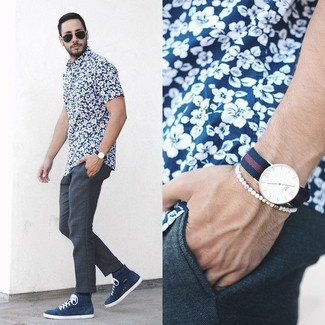 Consider pairing a navy and white floral shirt with charcoal trousers like a true gent. Throw in a pair of navy high top sneakers for a more relaxed aesthetic.