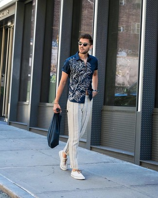 How to wear: navy and white floral short sleeve shirt, white and navy vertical striped chinos, white canvas low top sneakers, navy canvas tote bag