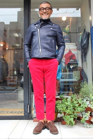 How to wear: navy leather biker jacket, black turtleneck, hot pink chinos, dark brown suede derby shoes