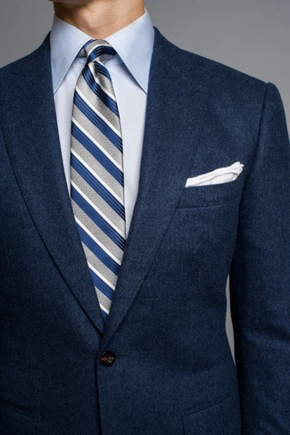 How to wear: navy wool blazer, light blue dress shirt, grey vertical striped tie, white pocket square