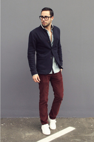 Try pairing a dark blue coat with oxblood jeans for your nine-to-five. Break up your ensemble with more casual footwear, such as this pair of white low top sneakers. There are plenty of ways to look great and live through the heatwave, and that's one of them.