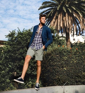 How to wear: navy knit blazer, navy plaid long sleeve shirt, grey shorts, black and white canvas low top sneakers