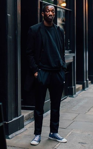 How to Wear Navy Sweatpants For Men: Make a navy blazer and navy sweatpants your outfit choice to bring out the dapper in you. Avoid looking too formal by finishing with navy and white canvas high top sneakers.