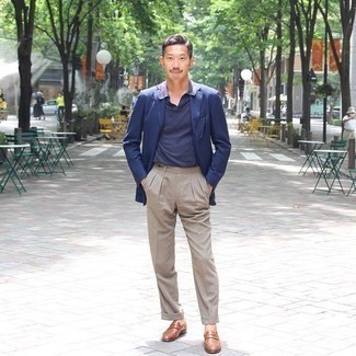 Navy Polo Outfits For Men: This outfit with a navy polo and khaki dress pants isn't a hard one to assemble and leaves room to more creative experimentation. Let your outfit coordination credentials really shine by rounding off your look with a pair of brown leather loafers.