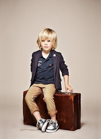 How to wear: navy blazer, navy polo, tan trousers, navy boat shoes