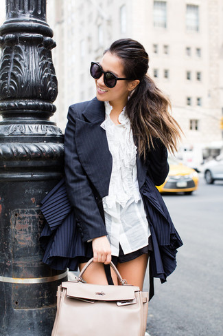 How to wear: navy vertical striped blazer, white ruffle dress shirt, black shorts, beige leather tote bag